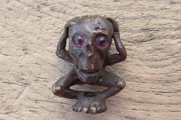 Cast Bronze Bead Homme Outré (Bizarre Man) with Real Garnet Eyes