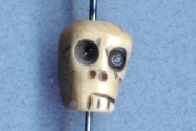 Hand-Carved and Painted Smoked Skull Bead