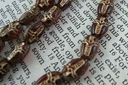 Tiny Pressed Dark Red Glass Crucifix Bead with Golden Highlights