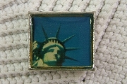 Bead Featuring a Close-Up Photograph of the Statue of Liberty