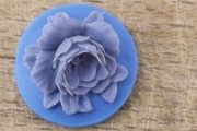 Round Cabochon featuring an Blue Rose on a Bluer Background