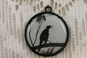 Pretty Black Enamel-Backed White Circle Crow Charm or Pendant: Lonely Crow (on Branch)