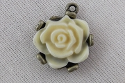 Enchanting Ivory Flower Charm