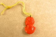 Vintage Pressed Orange Glass Charm - Woman's Profile