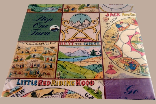 Two Folded Sheets of Vintage Games Fine Gift Wrap