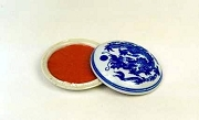 Red Tael Ink in White Porcelain Container
