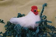 Old Store Stock Feathered Hen Ornament with Hand-Painted Features.