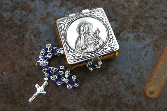Miniature Rosary in Glass Case with Embossed Image of Virgin Mary on Metal Door