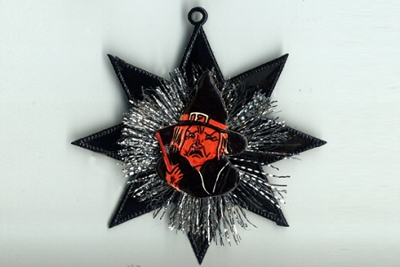 Vintage Scrap Witch & Tinsel Ornament on Black Dresden Star
