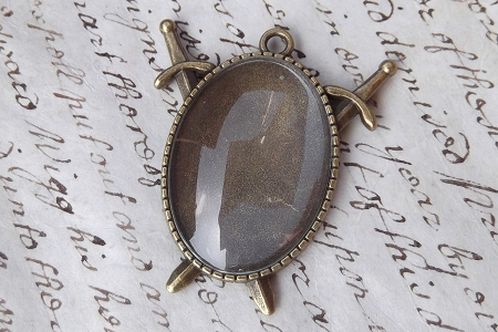 Do-It-Yourself Oval Pendant with Sword Enhancements and Glass Cabochon