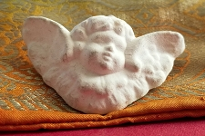 Vintage Primitive Style Patinaed Ivory Cherub Brooch / Pin