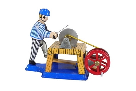 Man at His Whetstone New Old Stock Tin Cranked Toy