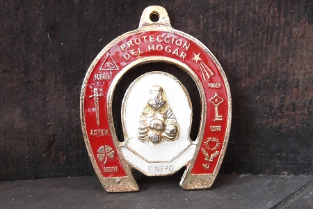 Small Red Metal Herradura Amulet