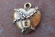 Antiqued Bronze Heart Under Lock and Chain
