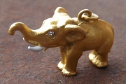 Vintage Golden Elephant Charm with White Tusks and Crystal Eyes