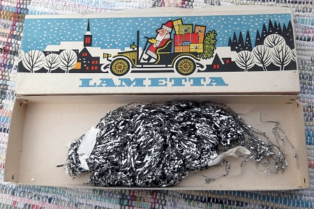 Rare Vintage Box of Silver Lametta featuring Santa Driving a Truck Full of Toys