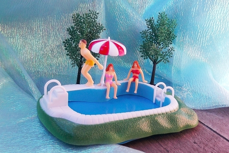Miniature Swimming Pool with 3 Little People Enjoying the Water