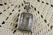 Sterling Silver Faceted Rutilated Quartz Pendant in Anti-Tarnish Pouch