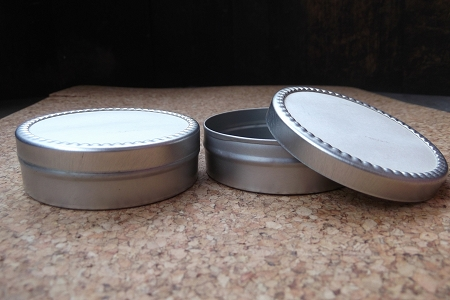 Cylindrical Tin with White Paper Slip Cover Lid