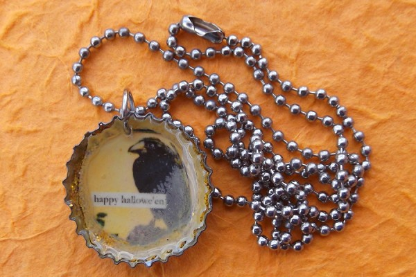 Handmade Bottle Cap Pendant featuring a Hallowe'en Crow on a Silver Ball Chain