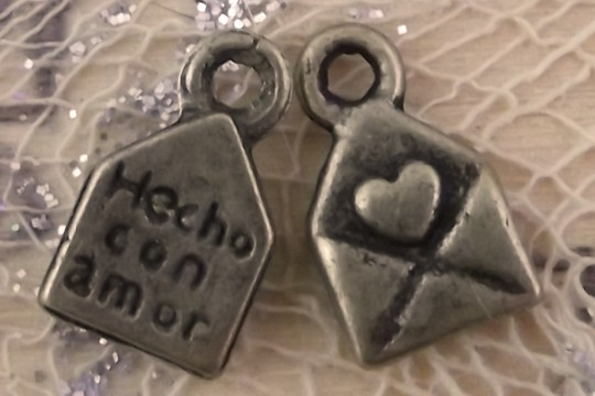 Tiny Hecho con Amor (Made with Love) Charm in Antiqued Bronze