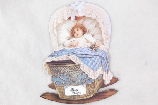 Small Die Cut - Little Baby in a Blue Cradle