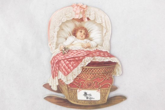 Small Die Cut - Little Baby in a Pink Cradle