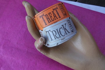 Trick or Treat Tickets tied with a Black Satiny Ribbon